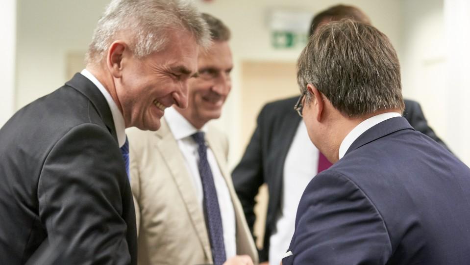 Laschet, Barnier, Oettinger
